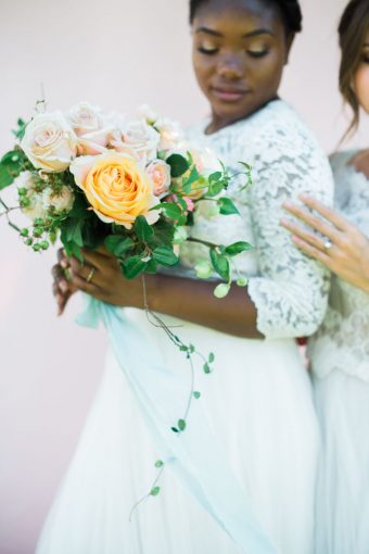 bride and her bridesmaids portrait together with beautiful bouquet