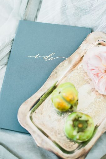 vows book with a silver tray with fruit and pink roses