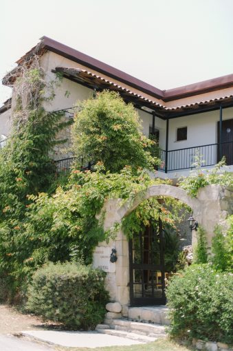 the outside of the country house with beautiful foliage