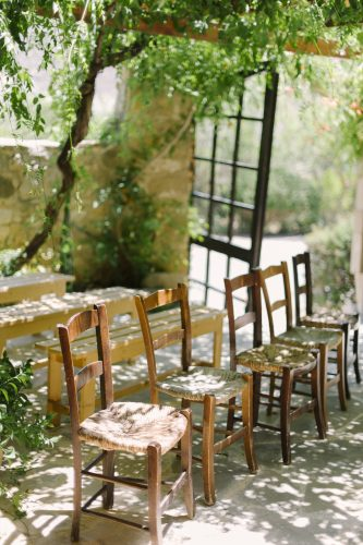 rustic chairs in a row for a wedding ceremony