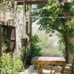 courtyard with wooden table and chairs