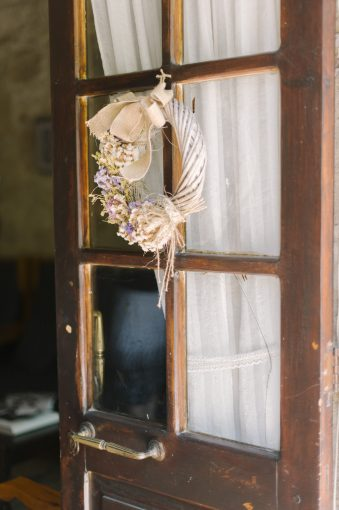 rustic decor hung from the door
