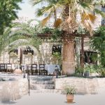 palm trees and tables for wedding guests to be seated