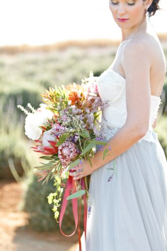 bridal bouquet with trailing ribbons and protea flowers