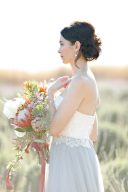 bride holding a huge bouquet with trailing ribbon