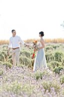 couple holding hands amongst the beautiful field of lavender