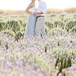 couple in the distance embrace surrounded by lavender