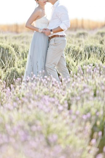 details of couples outfit surrounded by lavender