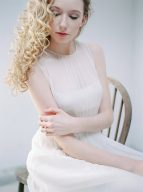 bridal portrait seated on a wooden chair