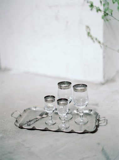 silver serving tray with beautiful silver rimmed glassware collection