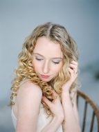bridal portrait head shot with tumbling curls and gentle hands