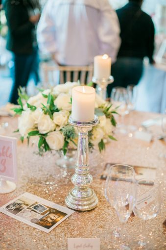 table setting with tall candles and sequin tablecloth