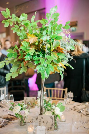 tall centrepiece with leaves and foliage