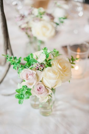 floral arrangement with roses and foliage