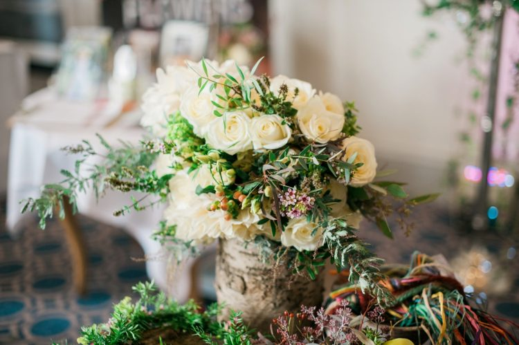 rustic centrepiece with tree trunk encasing roses