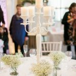 white table setting with candles