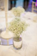 white table setting with small floral arrangements