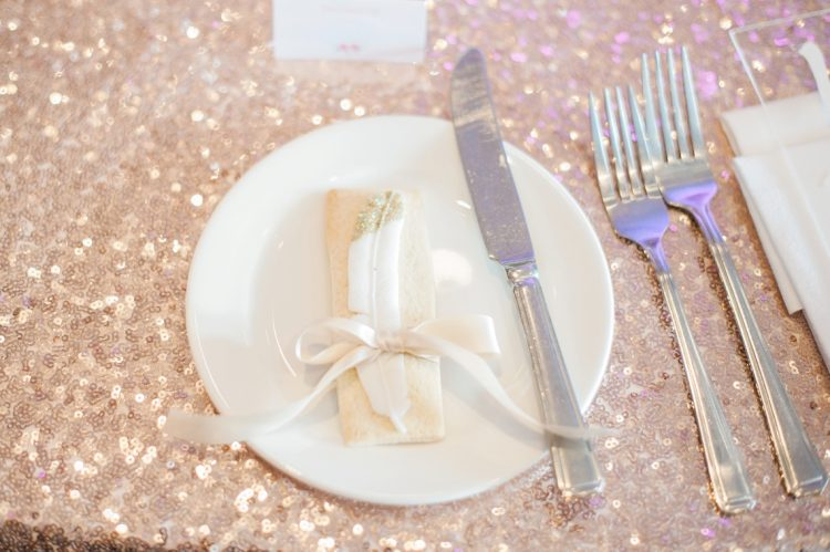 rose gold sequin tablecloth with plate and featu=her biscuit