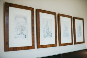 gallery wall of framed sketches