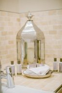 luxury beauty products in the bathroom and silver lantern