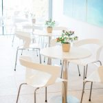 dining area with contemporary white tables and chairs