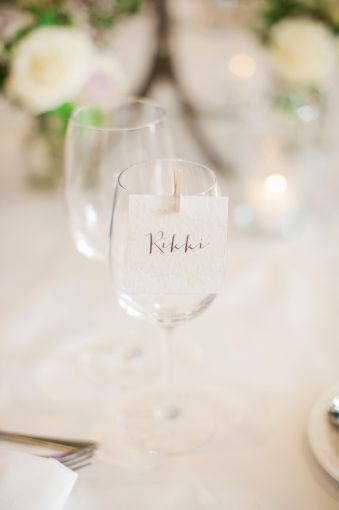 wine glasses with tiny peg holding a name card