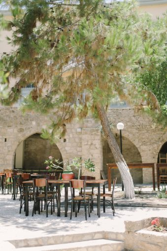 courtyard with table and chairs under trees