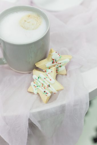 star shaped biscuits with icing and coffee mug