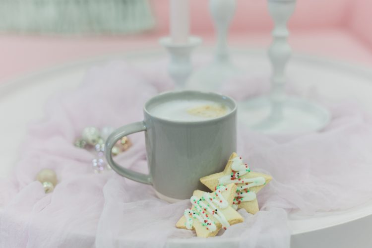 pretty coffee table displa with grey dip glazed mug of coffee and star biscuits for Christmas