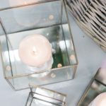 glass cube display cases with candles inside to create a lovely display