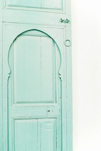 turquoise wooden antique door in Morocco