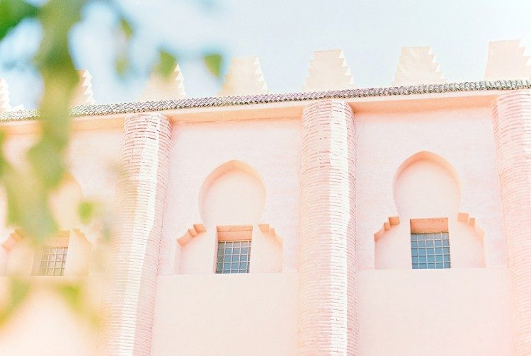 windows and architecture of beautiful pink building in Morocco