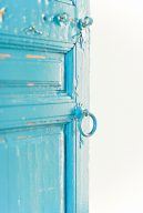 bright cobalt blue wooden door with peeling texture