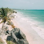 Tulum Mexico beach lined with palm trees