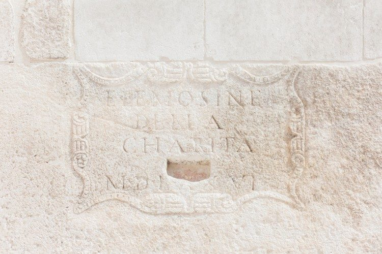 cream wall stone carving and lettering