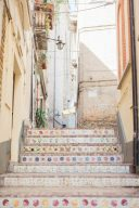 stone steps with colourful tiles in Italy