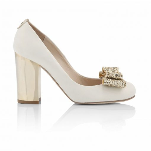 white court shoe with gold heel and gold glitter bow