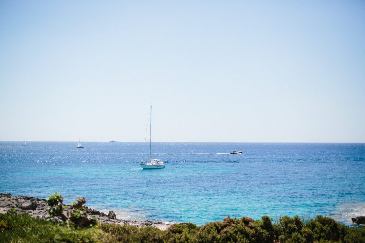 blue ocean with yachts in Menorca