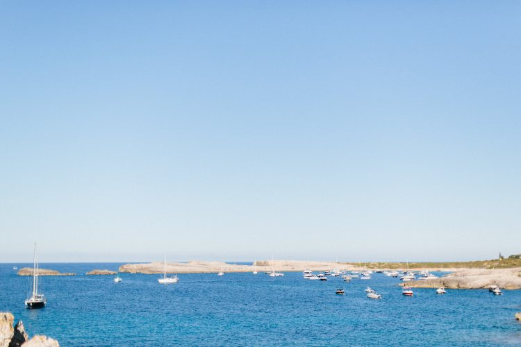 mny yachts and sail boats out on the seas along the coast of Menorca