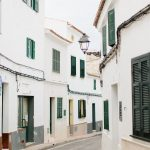 winding street and white buildings in Menorca