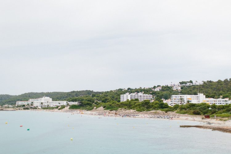 coastline of Menorca with ocean and buildings