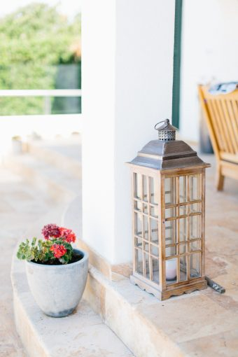 rustic lantern sat on the steps of the villa