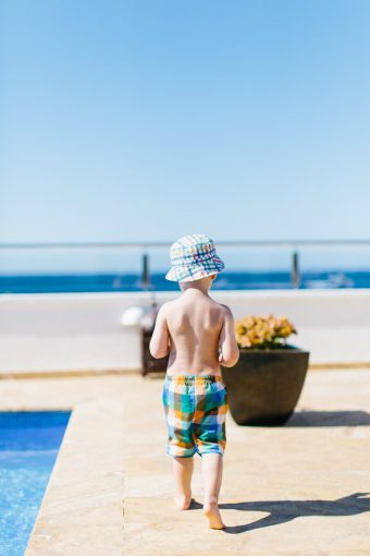 child walking to the swimming pool