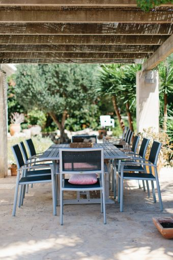 large patio table under a shade for alfresco dining