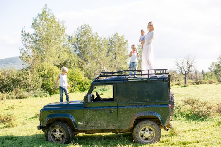family portrait sat on the roof of a Land Rover