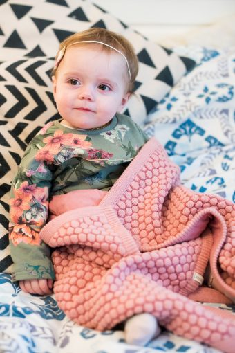 baby girl and the pink joolz organic baby blanket