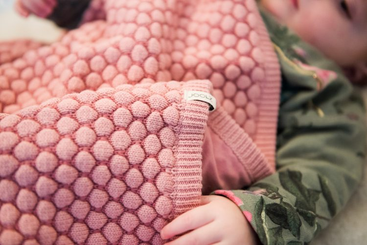 pretty pink baby blanket with honeycomb texture