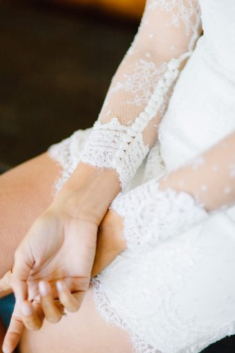 bridal portrait with lace sleeved wedding dress and contemporary jewellery