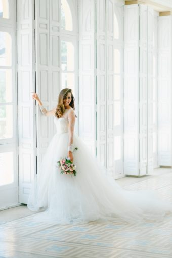 bridal portrait in light bright room of the castle