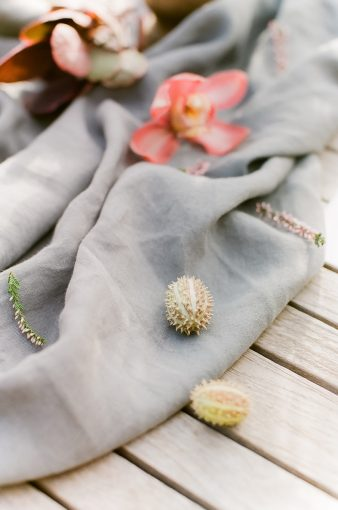 delicate table linen runner and flowers